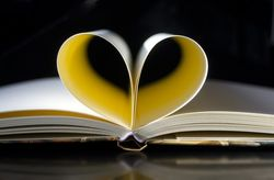 pages of a book folded to form a heart