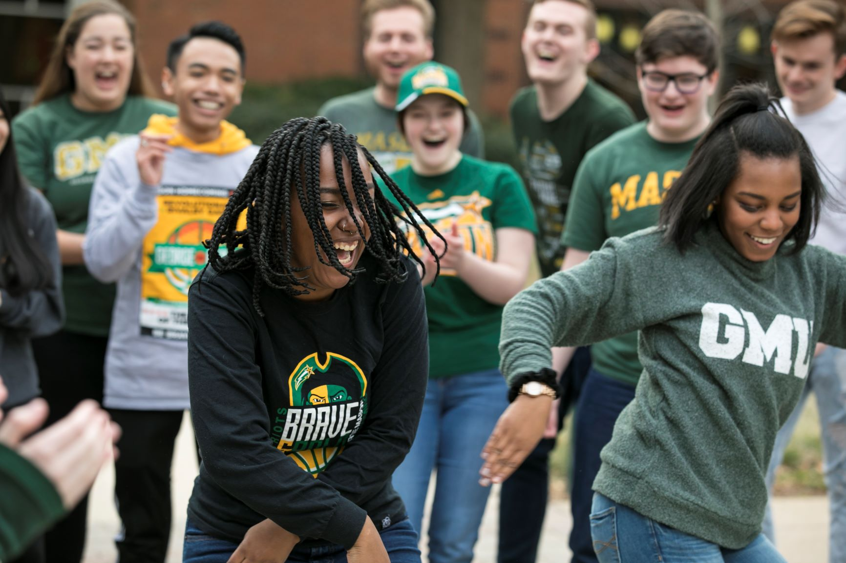 Mason students dancing About the Center